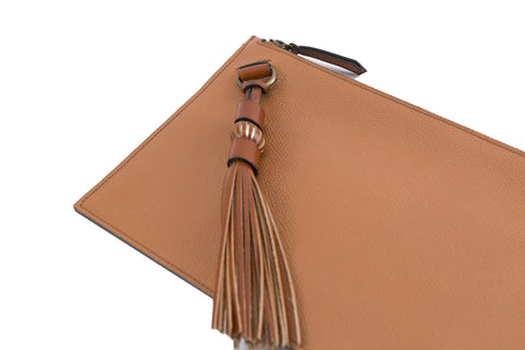 Milo clutch bag in caramel pebble grain leather