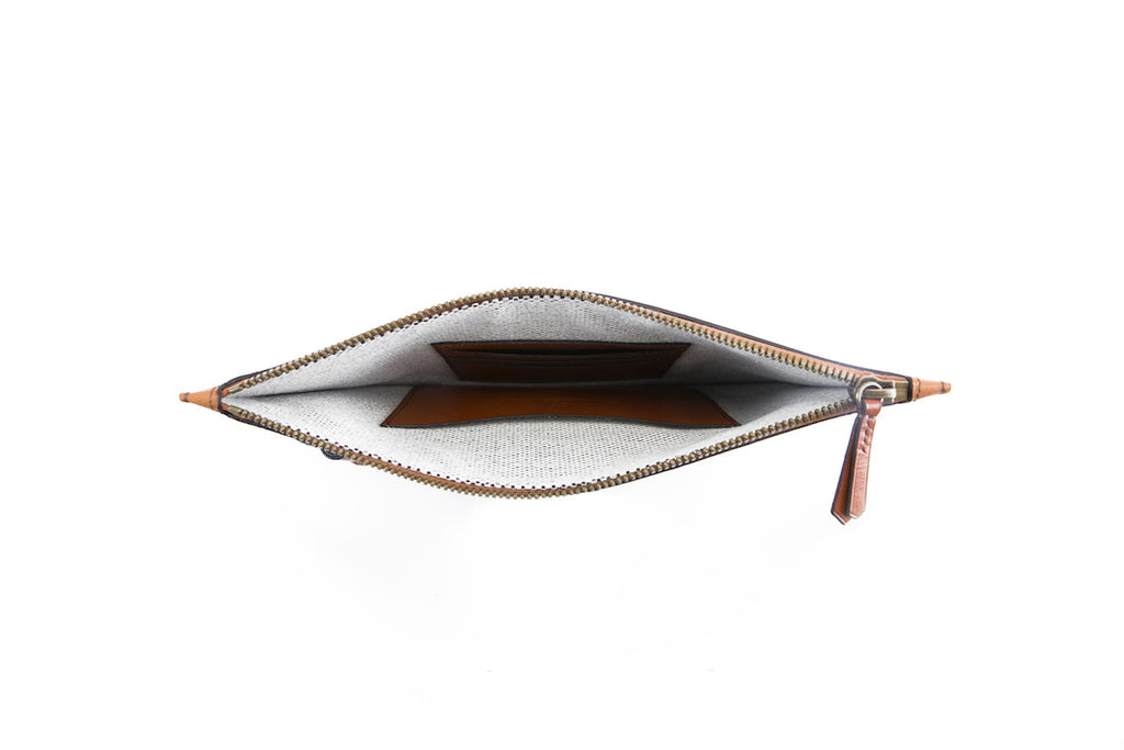 Milo clutch bag in caramel pebble grain Italian leather