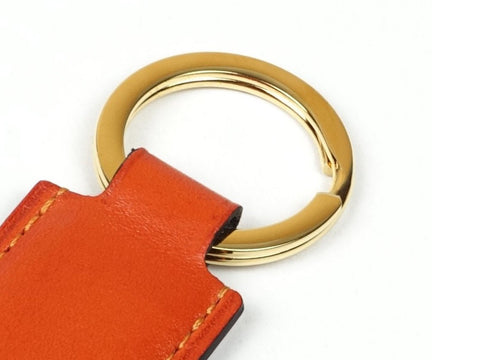 Saigon key ring with orange patina leather fob & gold ring