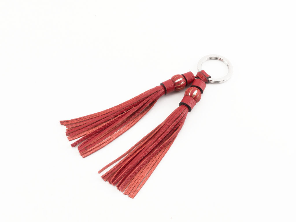 Saigon tassel pearl palladium key ring red leather tassels