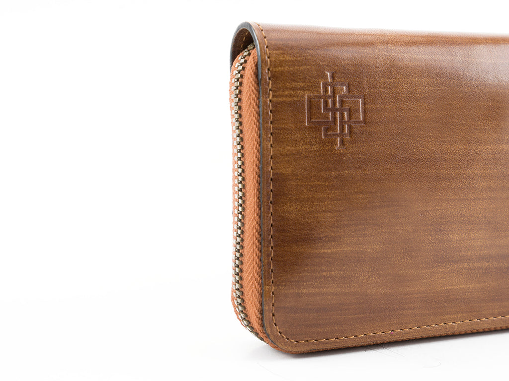 Phileas leather zip travel wallet in brushed wood patina