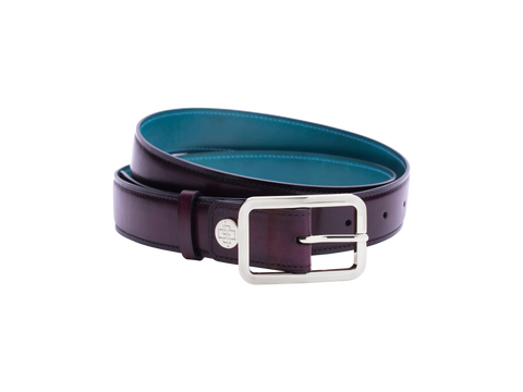 Leather belt with hand coloured patina and our French made custom made buckle in palladium silver. Pictured here in purple hand painted color patina. This is the 3cm width version which is more suitable for dress and smart casual with trousers. Made with Italian crust leather.