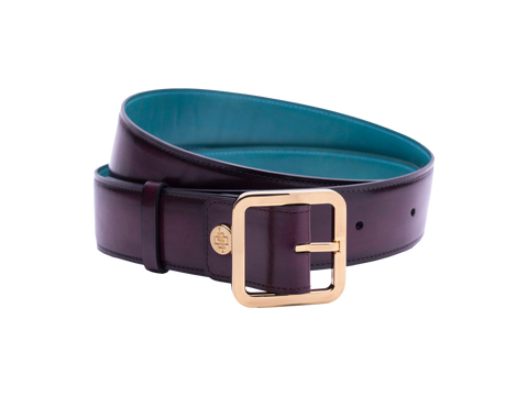 Our artisan made leather belt to wear by both men and women with hand painted coloured patina and French made custom made buckle in gold. These 4cm width belts are good for jeans and chinos. Italian crust leather and also the lining side is real leather. Here shown in purple hand painted hand colored patina.