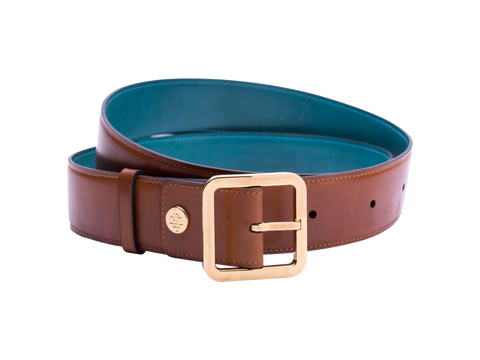 Our artisan made leather belt to wear by both men and women with hand painted coloured patina and French made custom made buckle in gold. These 4cm width belts are good for jeans and chinos. Italian crust leather and also the lining side is real leather. Here shown in tan hand painted hand colored patina.