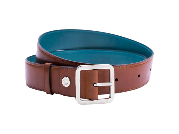Our artisan made leather belt to wear by both men and women with hand painted coloured patina and French made custom made buckle in palladium (silver). These 4cm width belts are good for jeans and chinos. Italian crust leather and the lining side is real leather. Here shown in tan hand painted hand colored patina.