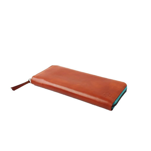 Zip travel wallet hand coloured patina leather in burnt orange