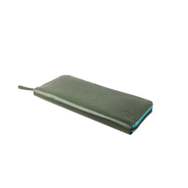 Zip travel wallet hand coloured patina leather in sage green