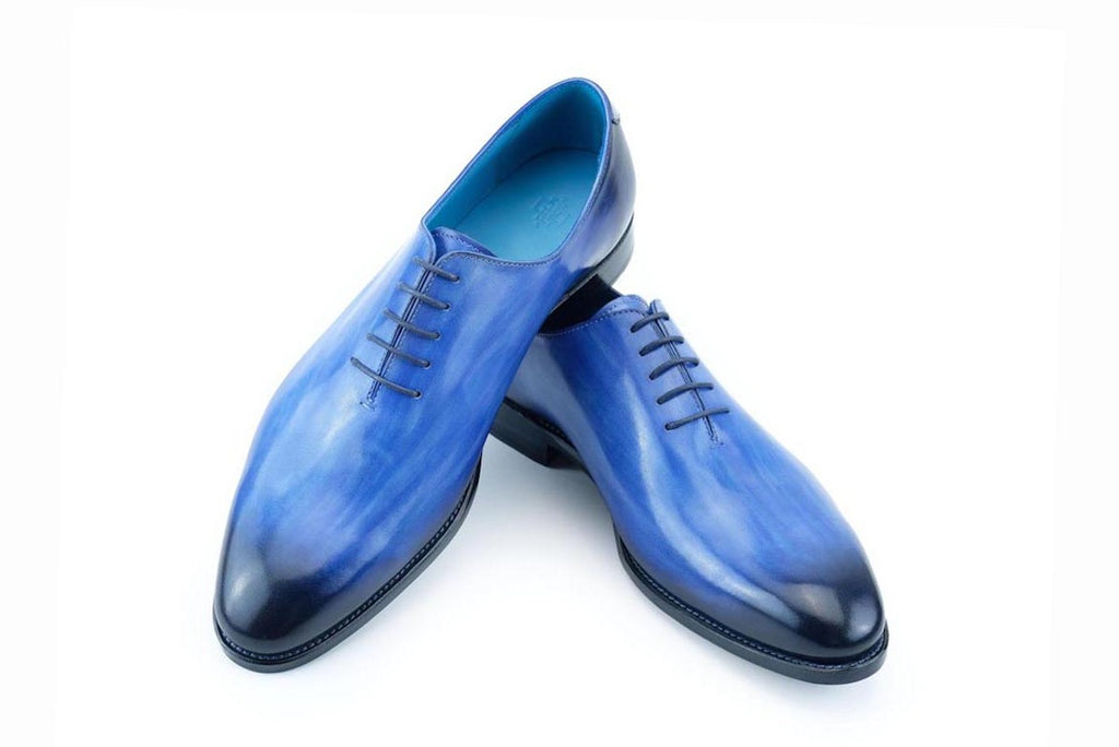 The Aristocrat whole cut shoes in cobalt blue patina