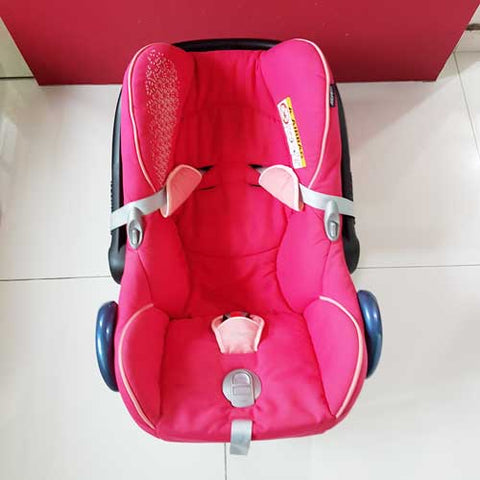 My son's pink car seat