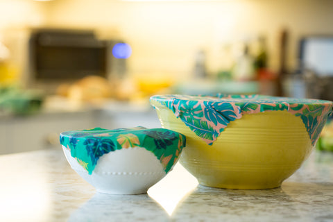 Two Meli Wraps Reusable Beeswax Wraps covering two bowls on a countertop.