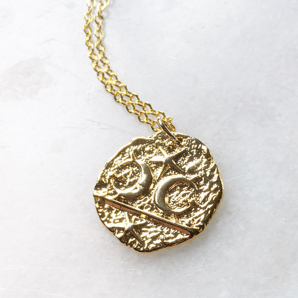 Stars and Moons Coin pendant