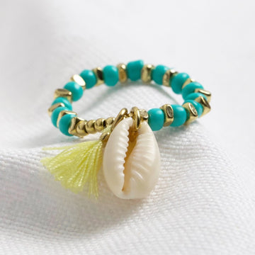 TURQUOISE BEADED STRETCH RING WITH SHELL CHARM