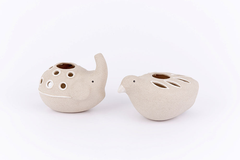 Bird meets elephant tea light holders
