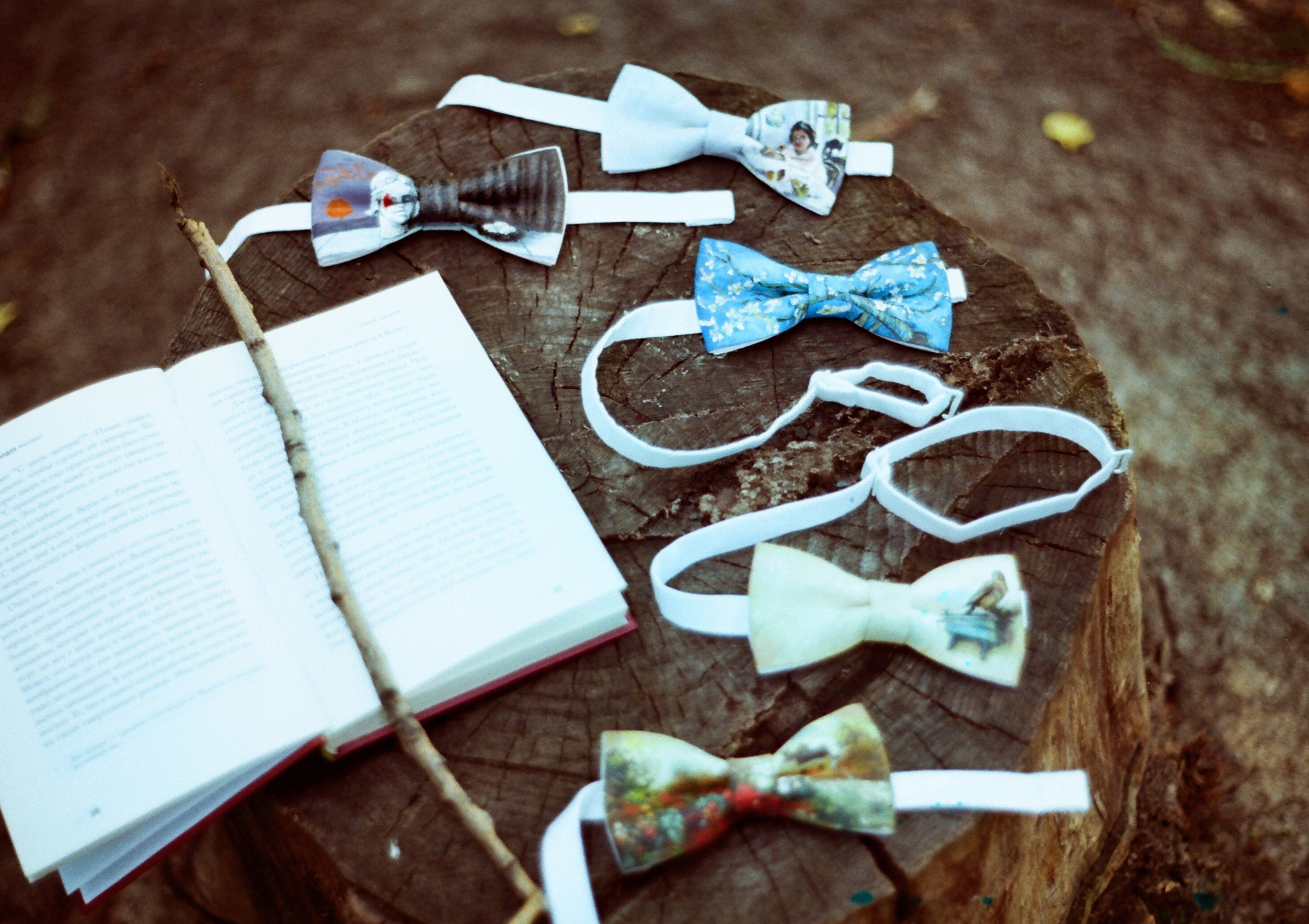 a number of Chin Up bow ties spread out