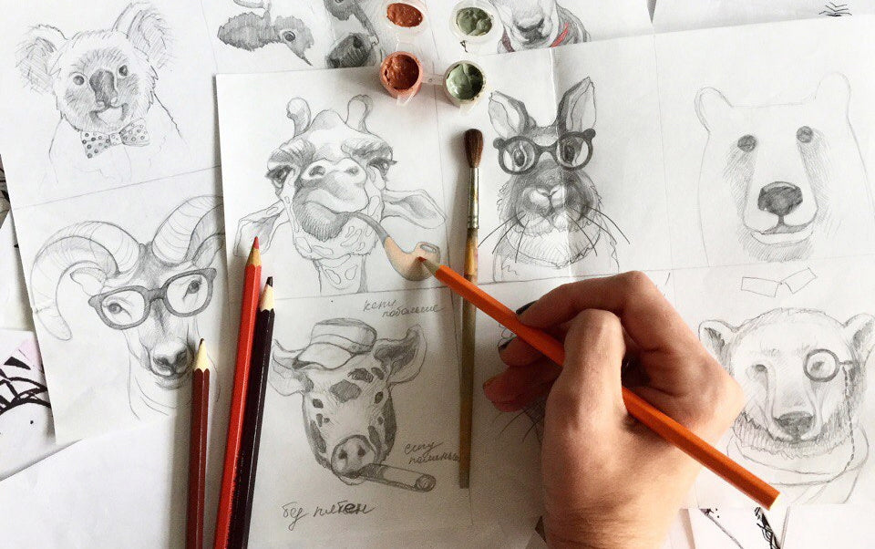 artist drawing visuals from Animal Faces collection