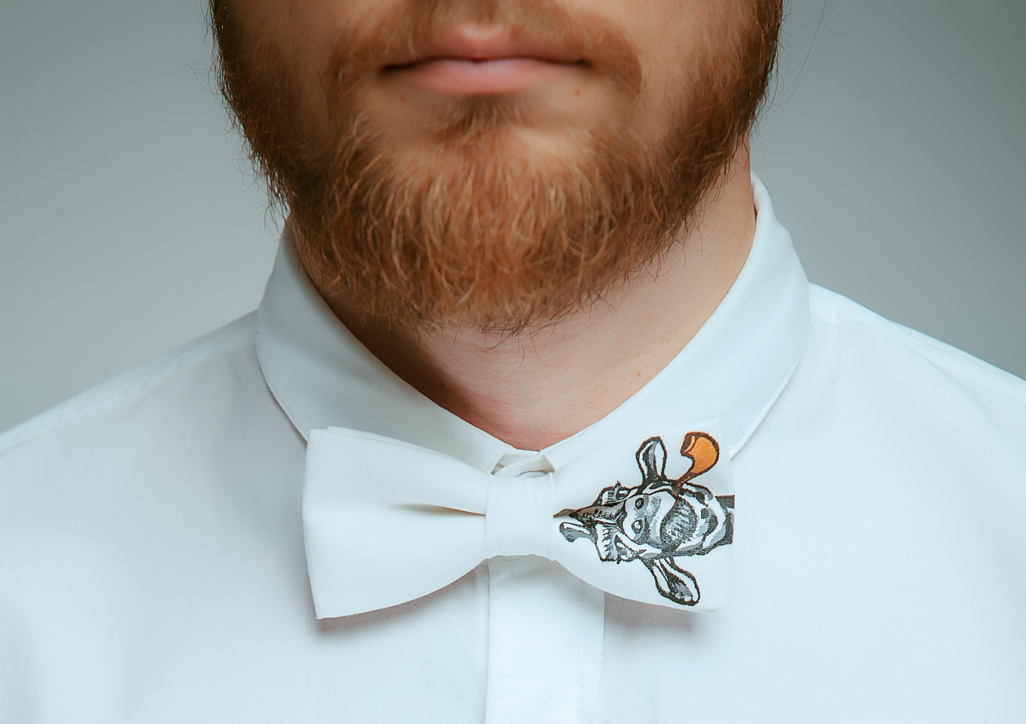 male model wearing a giraffe bow tie