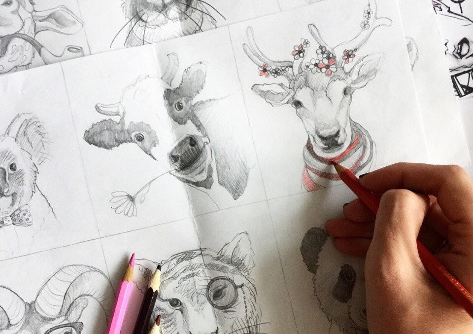 artist drawing visuals for Animal Faces collection