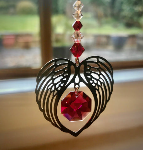 Metal heart shaped angel wings suncatcher with garnet Swarovski suncatcher
