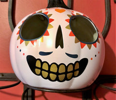 Day of the Dead decoration with white, orange and yellow decoration