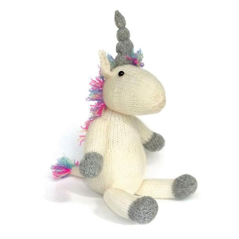 Cream knitted unicorn with a pink mane and tail and grey horn and paws