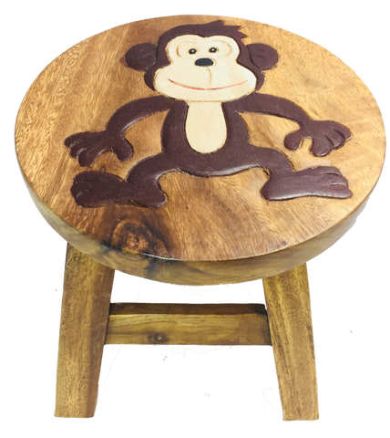 Small children's wooden stool with a picture of a dancing monkey on top
