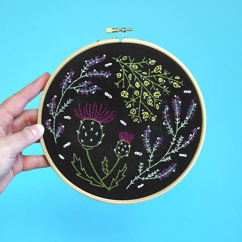 Highland Heather embroidery kit on black background completed - Peach Perfect