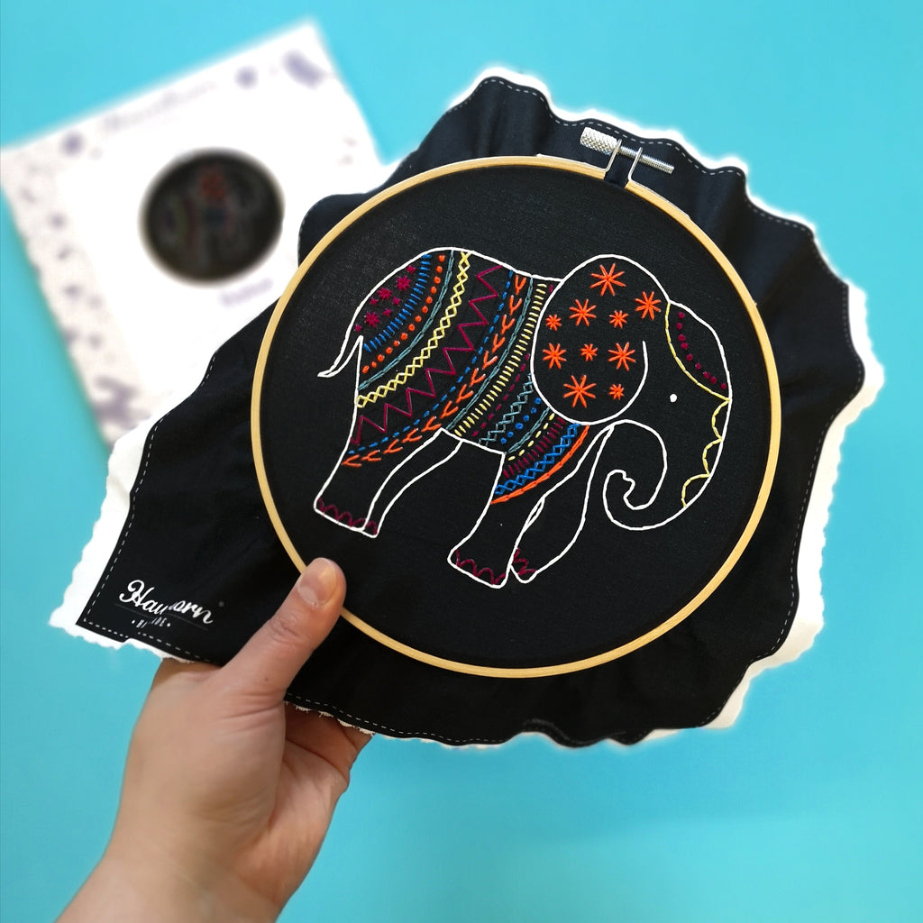 Black elephant embroidery kit held in the hand - Peach Perfect