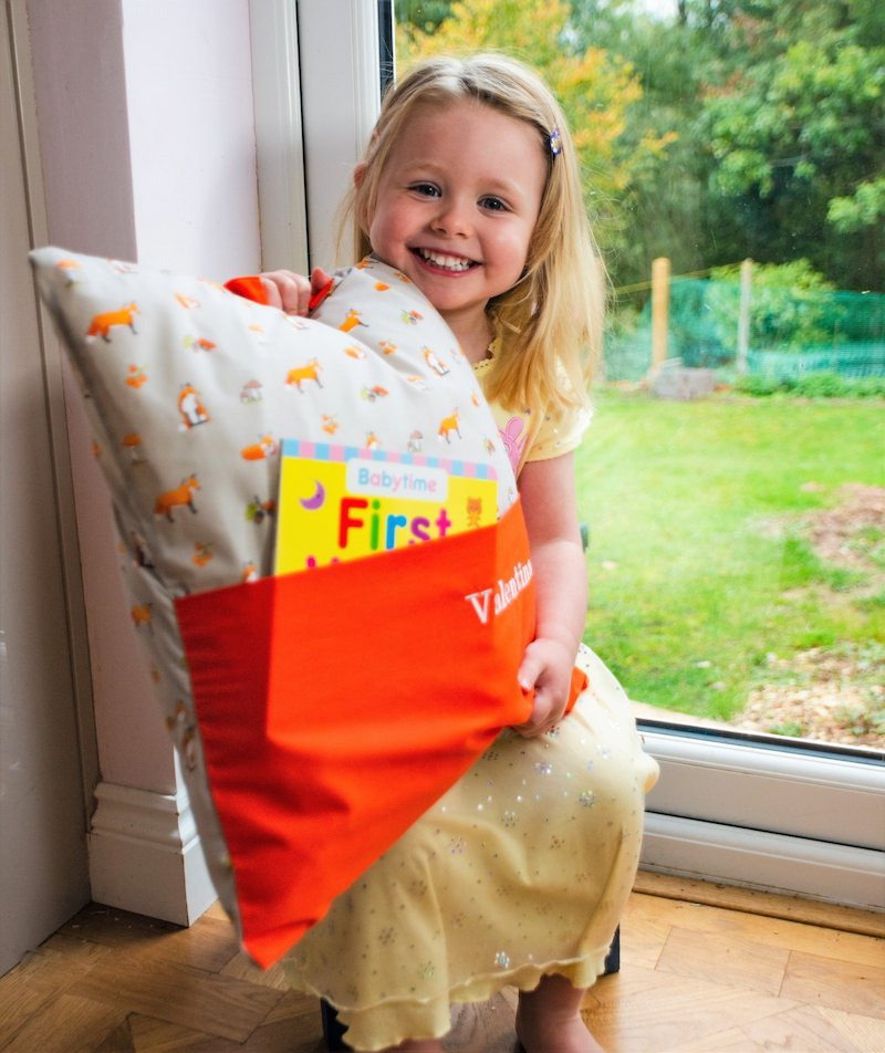 Child holding Book Cushion with book - Peach Perfect