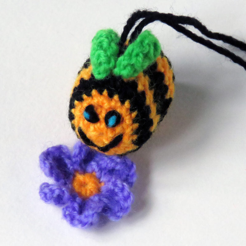 Made up simple crochet bee and flower