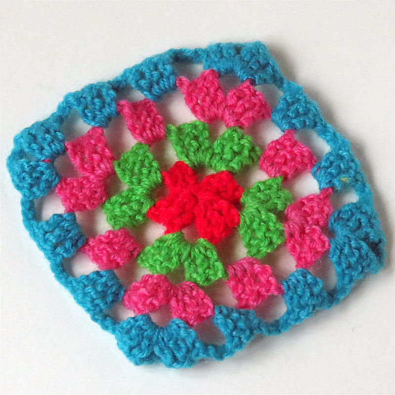 Made up craft kit project - crochet square in blue, pink, green and red