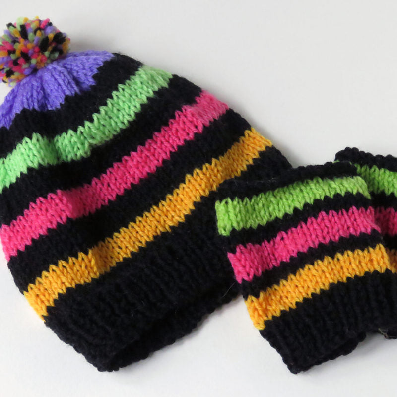 Made up craft kit project Hat and mitts in black with mauve, green, pink and yellow stripes and a multi coloured pompom