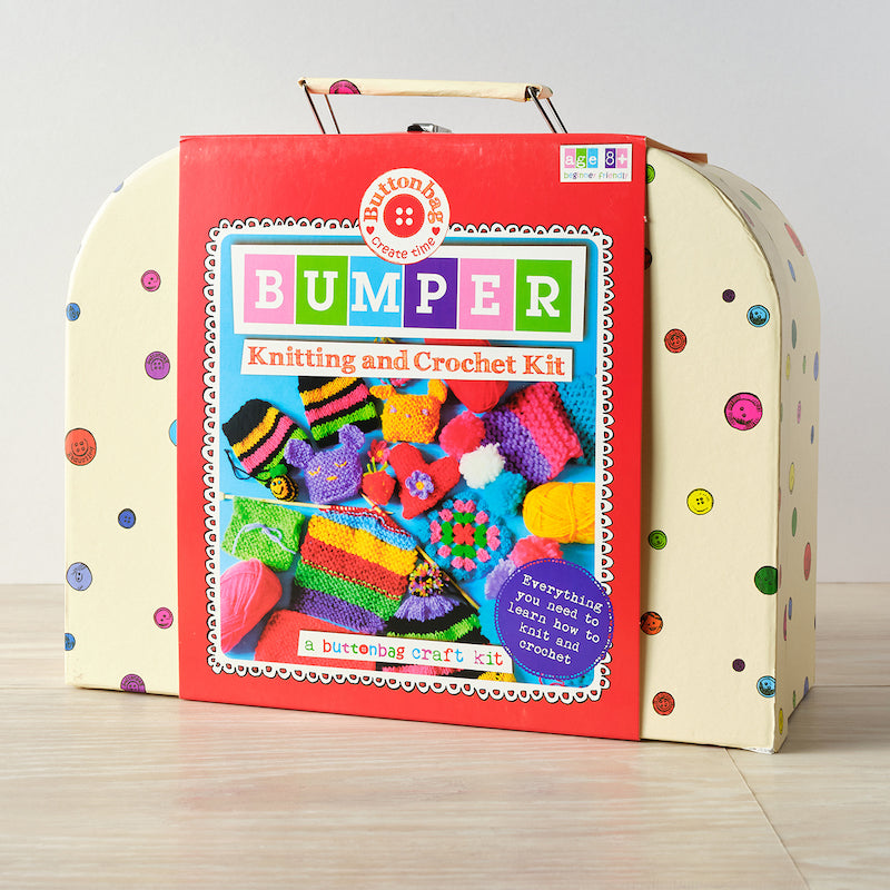 BUMPER Knitting & crochet kit suitcase - cream background with pictures of buttons and a red wrapper showing contents, Buttonbag craft kit, everything you need to learn how to knit and crochet and AGE 8+