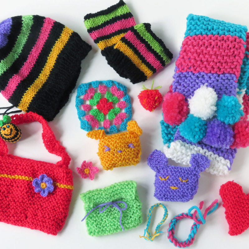 Knitting and crochet projects in the BUMPER knitting and crochet kit - hat, mittens, scarf, pompoms, purse, animals