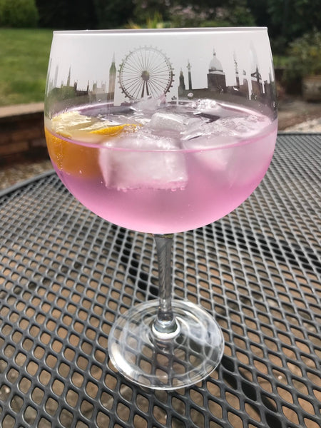Gin balloon glass decorated with London skyline frieze by The Milford Collection with pink gin - Peach Perfect