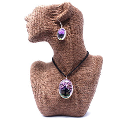 Lavender coloured pendant necklace and earrings shown on a wicker model