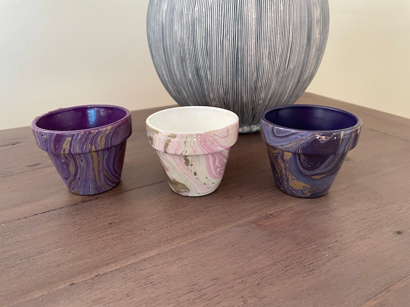 3 x Mini plant pots in mauve with gold swirls, pink on white with gold and dark blue/purple with gold