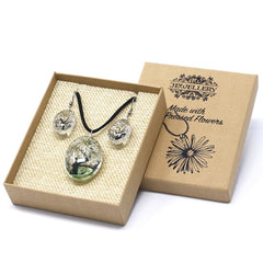 Pressed flower jewellery set with white flowers on a black tree in the cardboard presentation box with lid