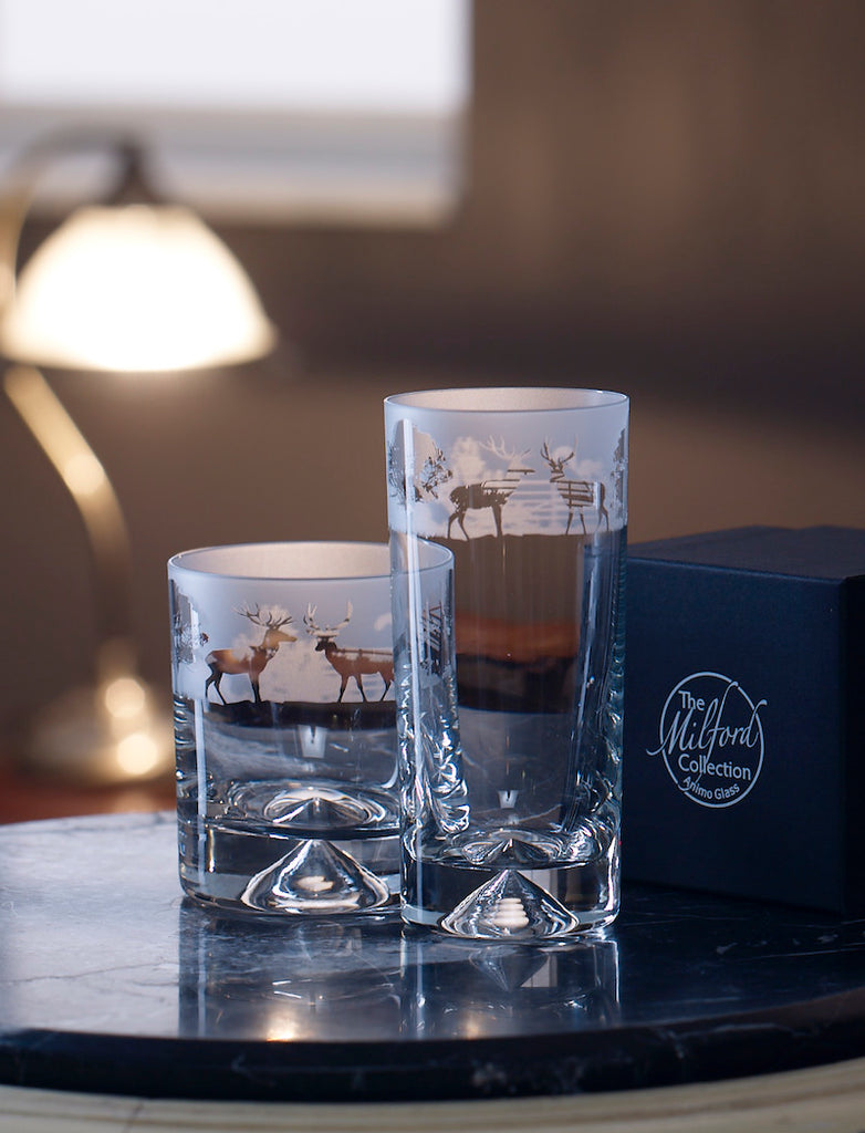 Tall glass & tumbler glass decorated with pictures of stags by a Milford Collection black gift box