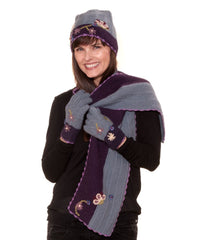 Model watering alpaca wool beanie hat, matching scarf and gloves in blue & purple with embroidered flowers
