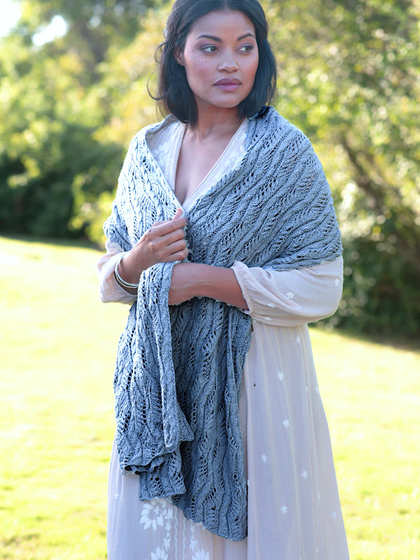 The Beaufort Scarf in a the color Lake 4063 wrapped around the shoulders of a young woman