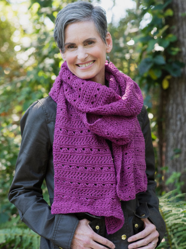 The Meander Scarf in a the color Magnolia 8337 on a smiling model