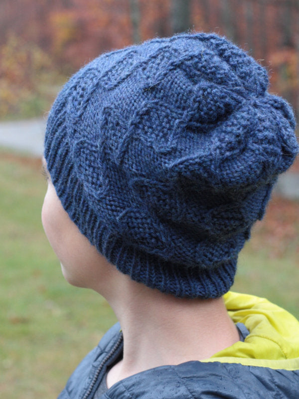The Nye hat inspired by deoxyribonucleic acid knit in Ultra Wool Worsted color Denim 33154.
