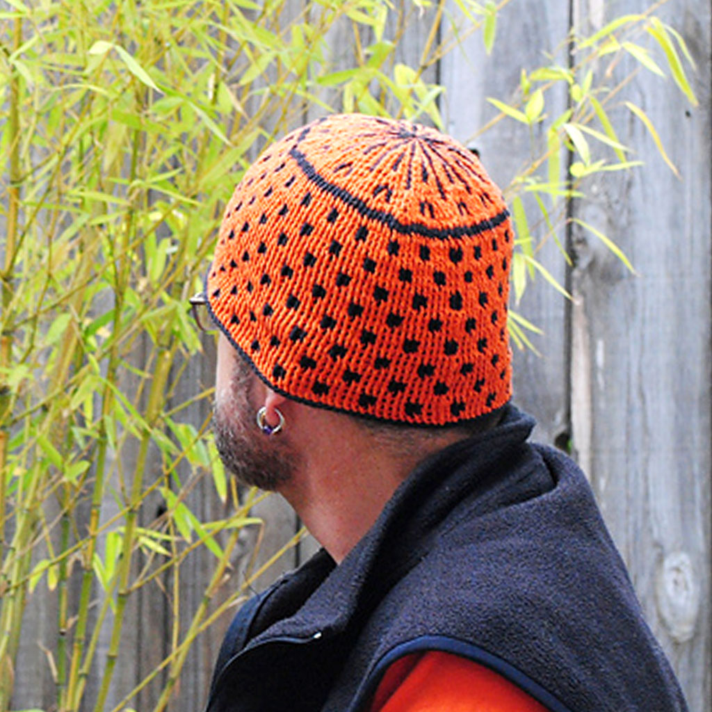 A Tempo Crochet Cap made with orange and black CoBaSi sock yarn.