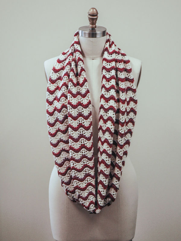 The Penelope cowl knit out of Berroco Ultra Wool DK in the colors Cream 8301, Sunflower 83122, and Heather 83153.