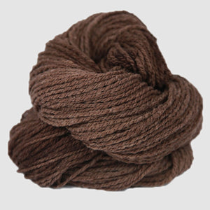 Color Cowboy Brown. A brown kettle-dyed skein of Mountain Meadow Cheyenne Aran Yarn.