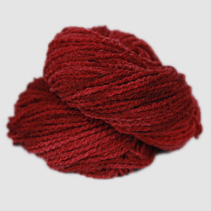 Color Russet. A red kettle-dyed skein of Mountain Meadow Cheyenne Aran Yarn.