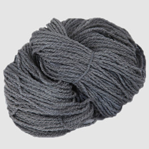 Color Silver. A light grey kettle-dyed skein of Mountain Meadow Cheyenne Aran Yarn.