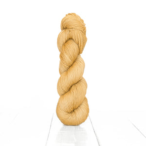 Color Acorn, hand-dyed skein of yarn, warm beige color produced from natural acorns.