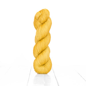 Color Acorn, hand-dyed skein of yarn, light yellow tan color produced from natural acorns.
