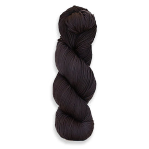 A twisted hank of Harvest Worsted hand-dyed black with Thuja.